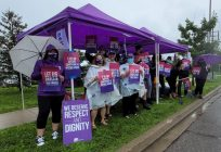 Health workers protest against wages, support outside of RVH